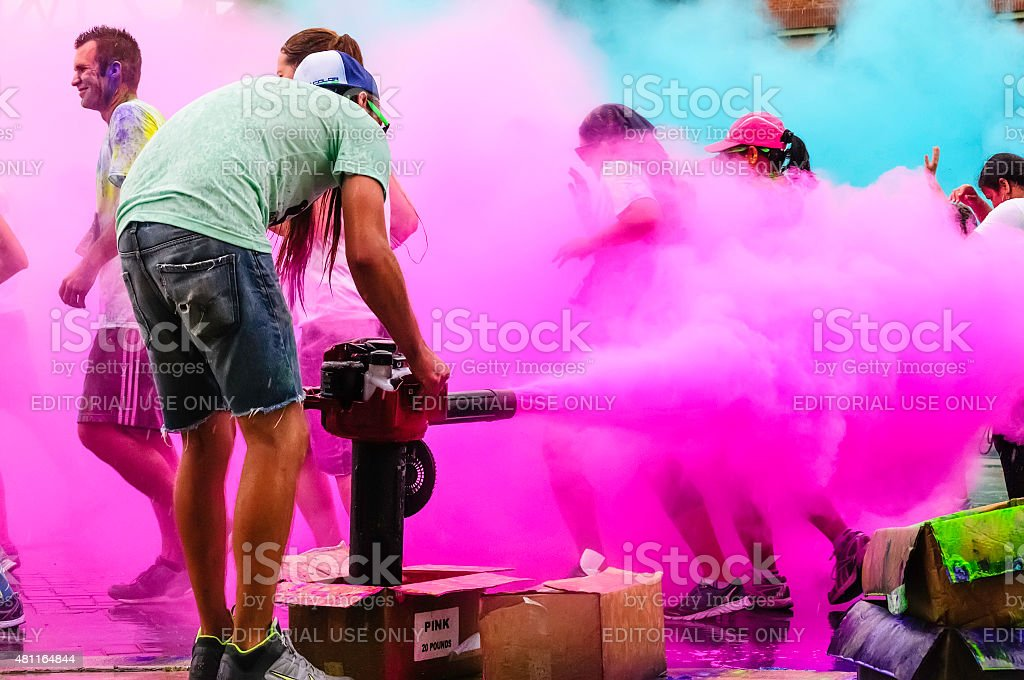 Creating a pink cloud at recreational 5K run stock photo