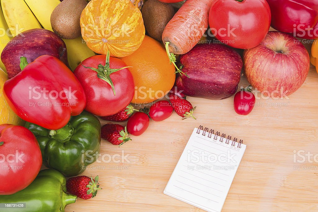 Creating a Recipe:fruit vegetable variety and note book stock photo