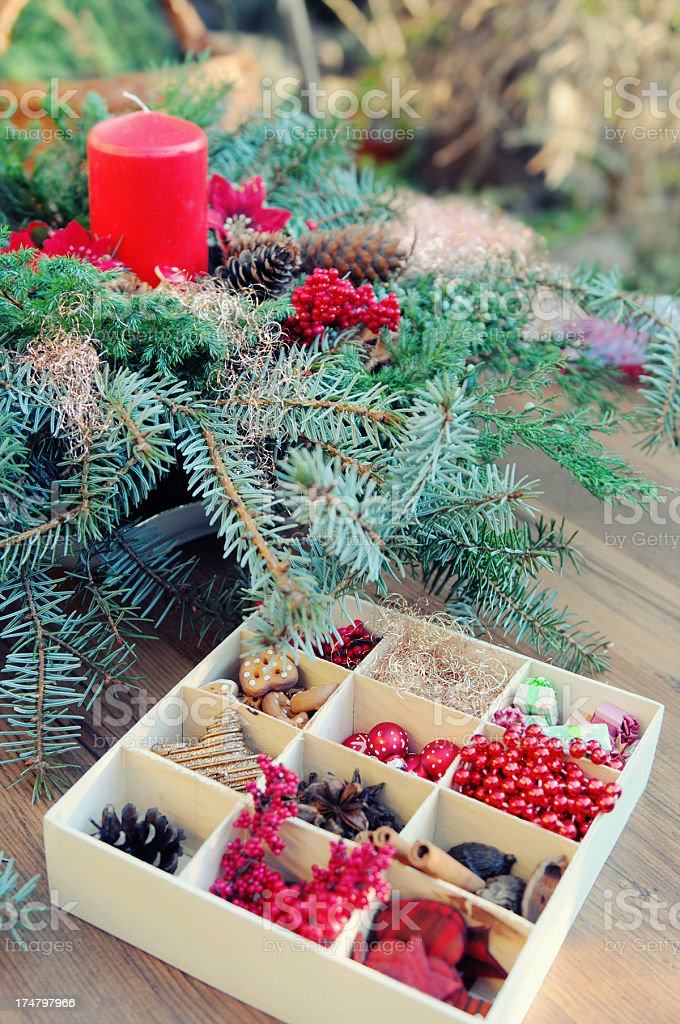 creating advent wreath with candle and ornaments royalty-free stock photo