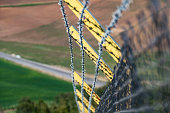 istock creating barbed fence to prevent smuggling and immigrants at the borders, 1149939298