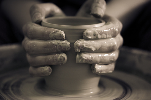 Creating ceramic products of white clay close-up