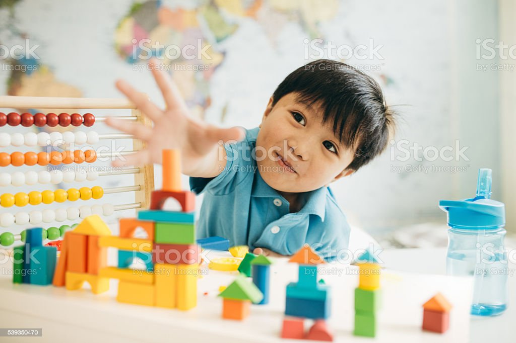 Creating new cities with wooden blocks stock photo