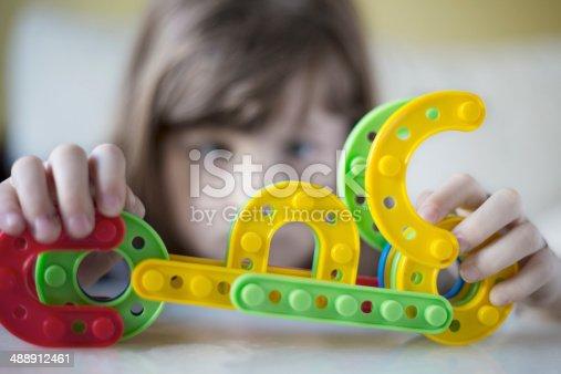 865870702 istock photo Creating new toy 488912461