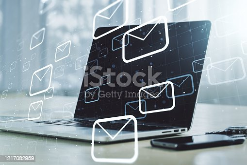 istock Creative abstract postal envelopes sketch on modern laptop background, e-mail and marketing concept. Double exposure 1217082959