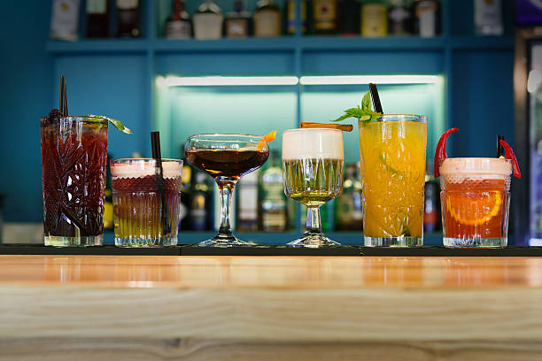 Creative alcohol cocktails in night club bar stock photo
