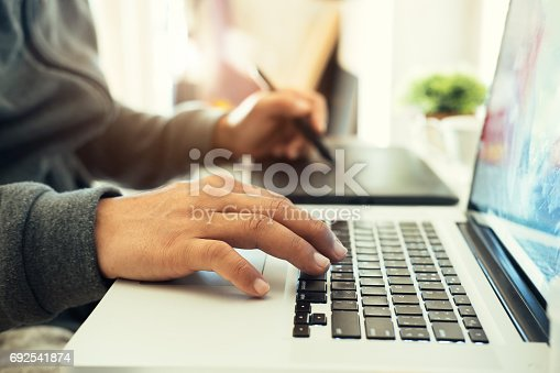 istock Creative and Designer Concept. Man using Graphic tablet. 692541874
