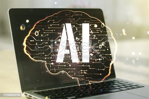 istock Creative artificial Intelligence concept with human brain hologram on modern laptop background. Multiexposure 1209893255