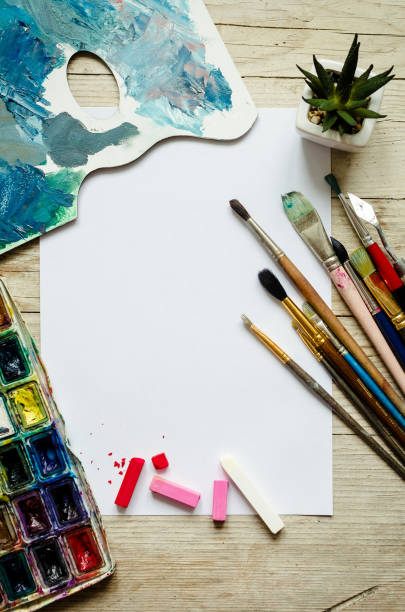 Creative artist workplace flat lay, mockup on wooden background stock photo