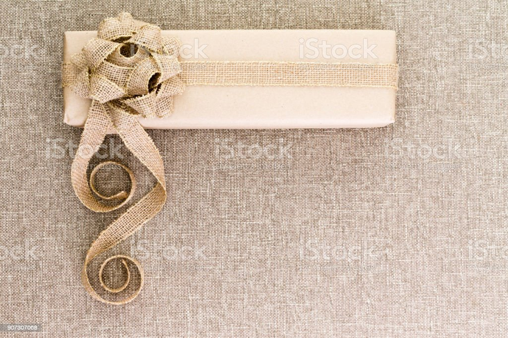 Creative artistic rustic Christmas gift on burlap stock photo