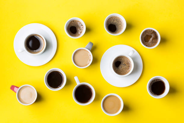 Creative assortment of cups and mugs with coffee stock photo