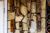 Creative background, stone wall with wooden elements