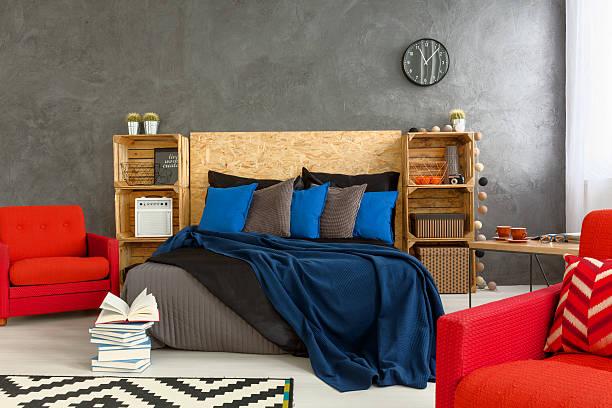 creative bedroom space - marineblau schlafzimmer stock-fotos und bilder