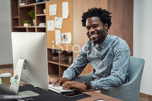 istock Creative black businessman working on computer 1059660844