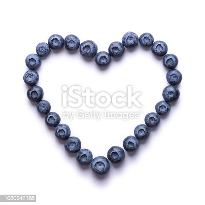 Creative blueberries in the shape of heart isolated on a white background.