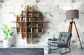 Creative Bookshelf Design with Armchair. 3D Rener