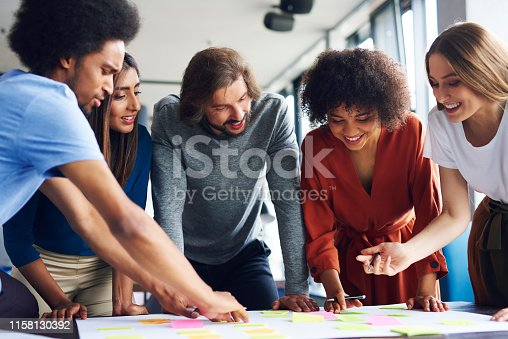 Creative business people planning with adhesive note