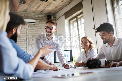 istock Creative business people working on business project in office 1077565558