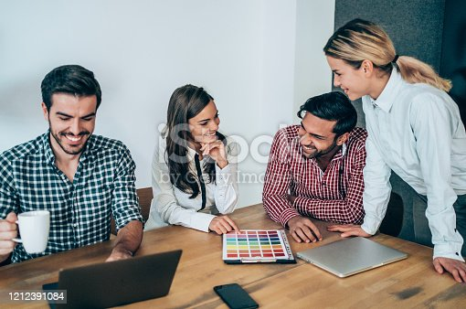 842214506 istock photo Creative business people working on business project in office. 1212391084