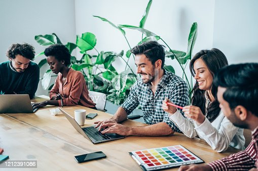 842214506 istock photo Creative business people working on business project in office. 1212391086