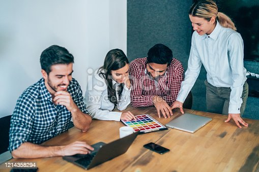 842214506 istock photo Creative business people working on business project in office. 1214358294