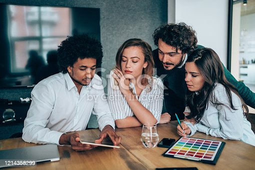 842214506 istock photo Creative business people working on business project in office. 1214358299