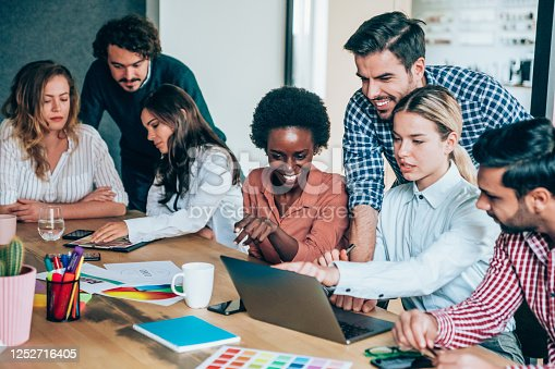 842214506 istock photo Creative business people working on business project in office. 1252716405