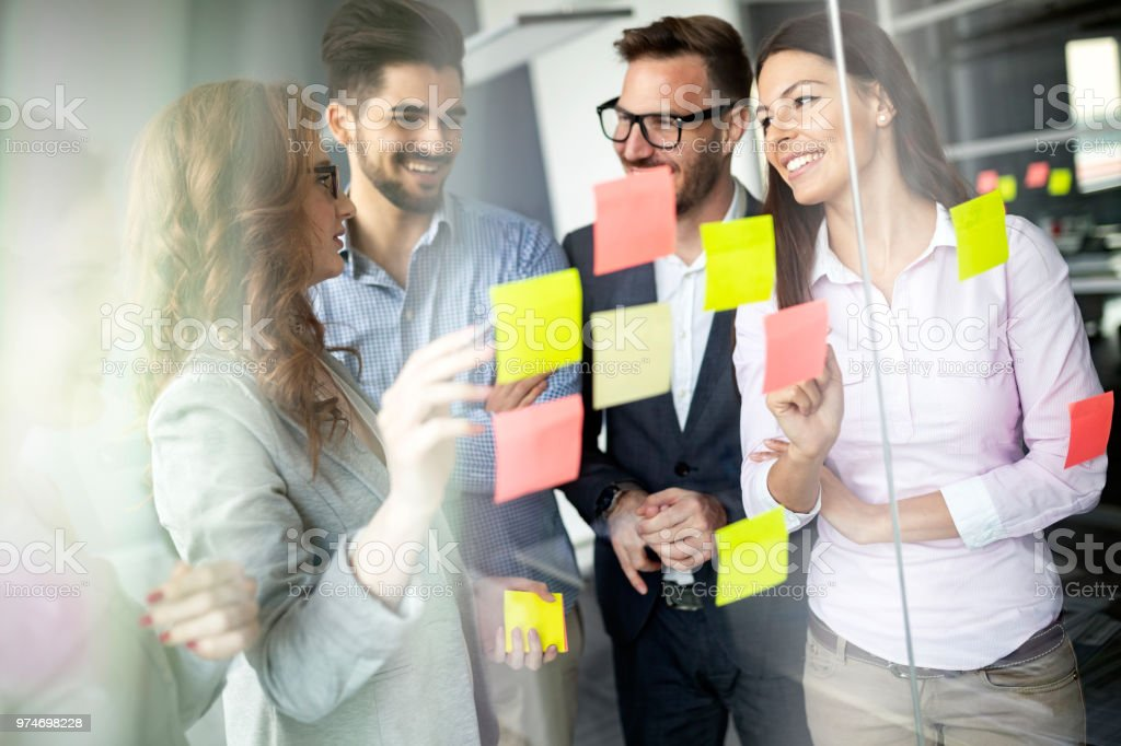Creative business people working on business project in office stock photo