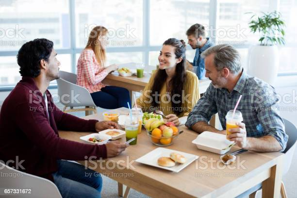 Creative business team discussing while having meal picture id657331672?b=1&k=6&m=657331672&s=612x612&h=k4evopf4hwz9sp4ozal8h0rj7h5mdtgt8c3s nuxgse=