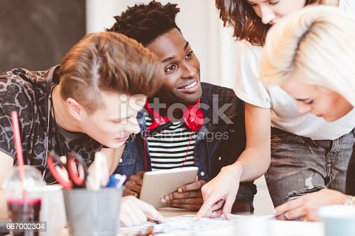 918746260istockphoto Creative business team working together in an office 667002304