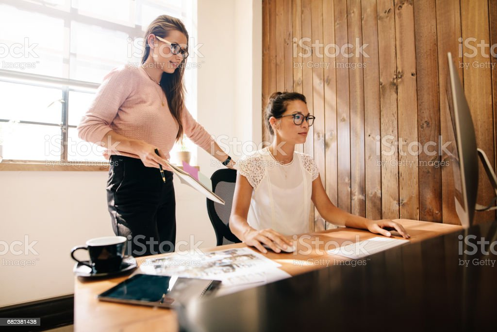 Creative business women at the office desk royalty-free stock photo