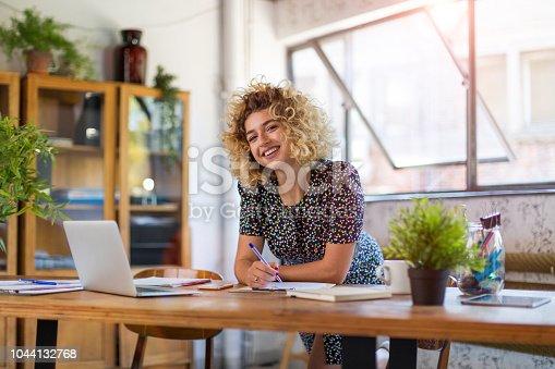 istock Creative businesswoman in office 1044132768