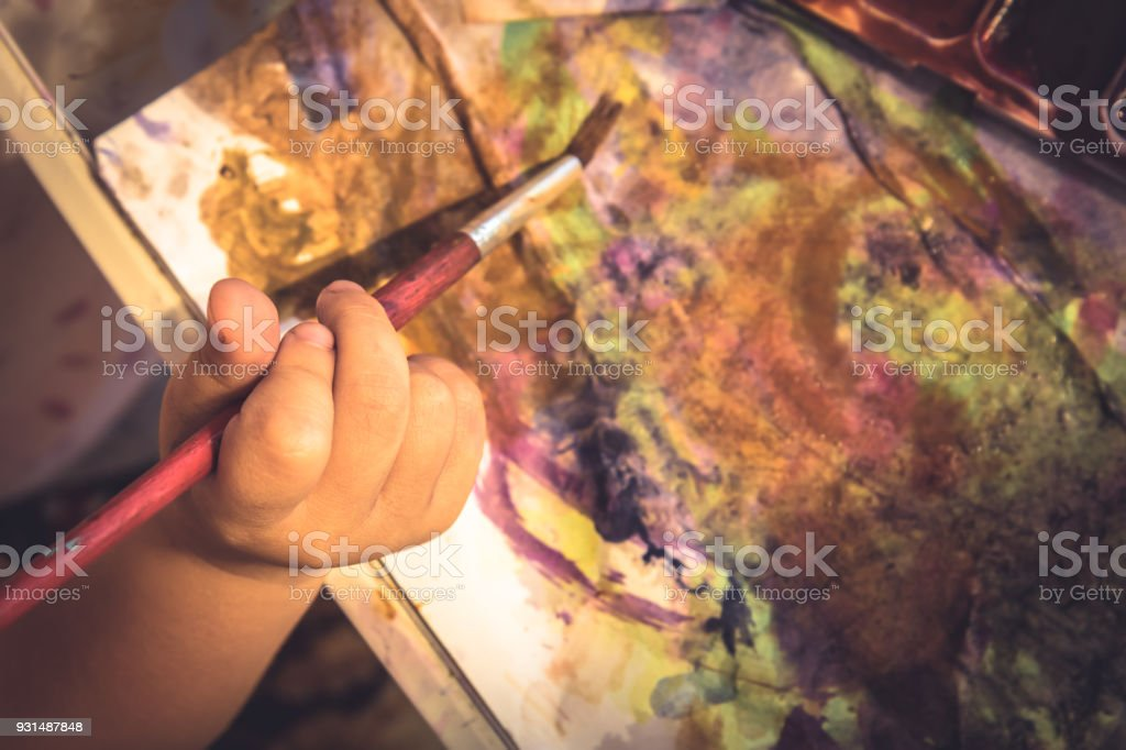 Creative child painter hand abstract paint concept creativity early...