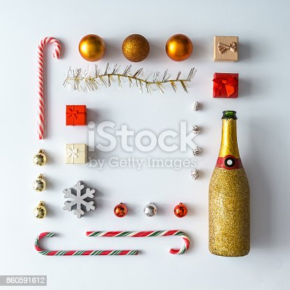 873264516 istock photo Creative Christmas layout made of christmas winter decoration and champagne. Flat lay. Nature New Year concept. 860591612