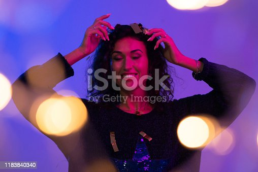 1071416330 istock photo Creative colorful portrait of young woman. Night club, celebrating 1183840340