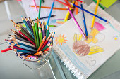 Creative atmosphere with vibrantly colored pencils and papers