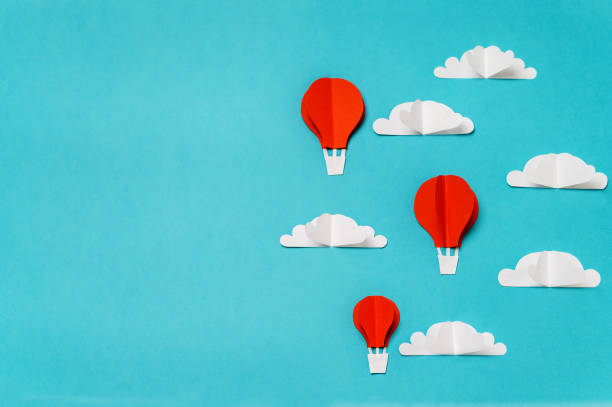 Creative concept for banner/landing/background designs with hot air balloons in clouds paper cut and origami objects. stock photo