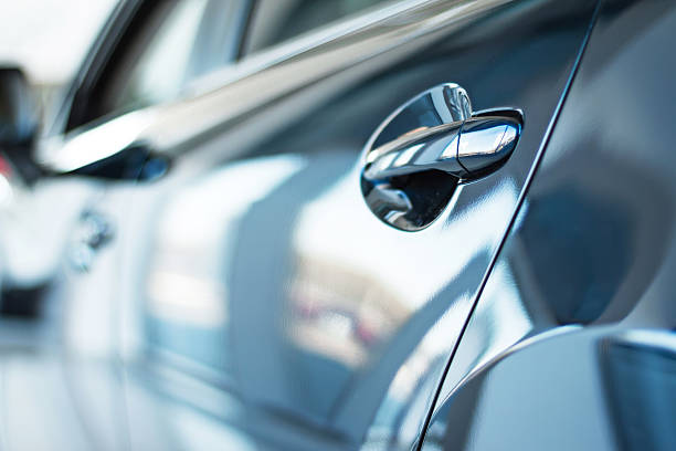 Creative concept for car rental Close up photo of new car door. Concept for car rental car show stock pictures, royalty-free photos & images