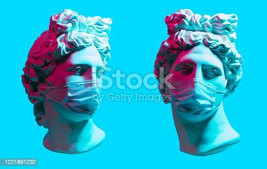 Creative concept of neon. Apollo statue In Medical Mask