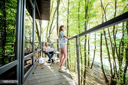 istock Creative couple of architects working outdoors at the forest house 1063420274
