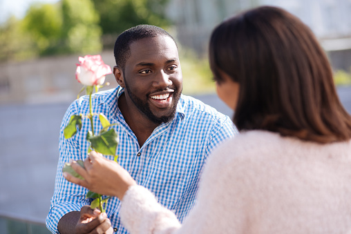 Image result for black man giving his lady flowers