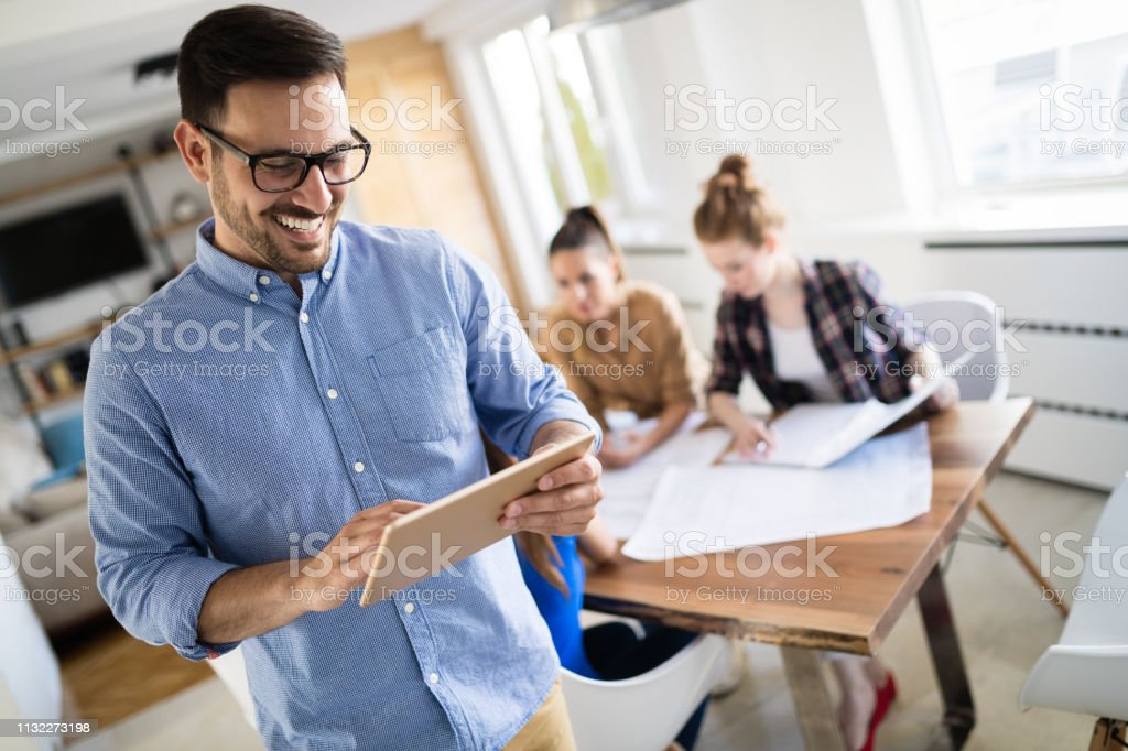 Creative coworkers working in office stock photo