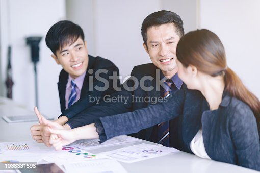 istock Creative Design People Worker Showing Thumb up Recommend teamwork,Smile businessman looking partner Teamwork. 1038331898