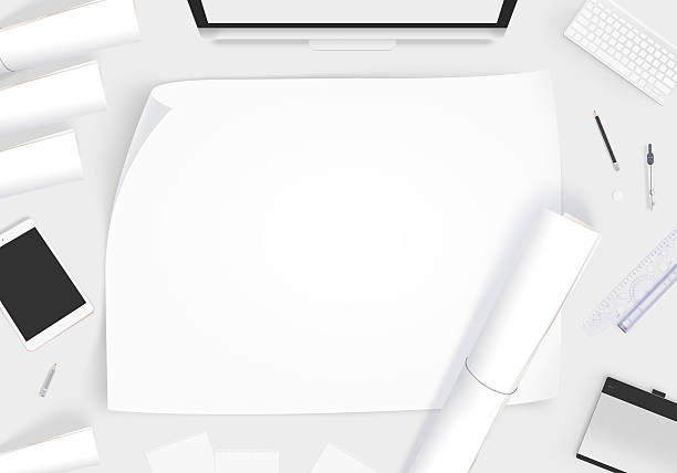 Creative designer desk with blank paper whatman mockup stock photo
