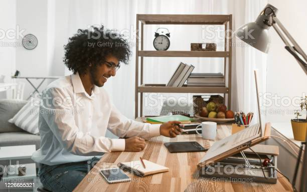Creative designer draws on a graphic tablet working from home young picture id1226655321?b=1&k=6&m=1226655321&s=612x612&h=jk9yzzrfvu6uiatlm3ld sxtxlez f ytvjzkhffxjy=