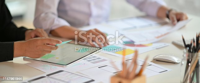 istock UI creative designer team designing wireframe layout for responsive mobile phone application 1147961944