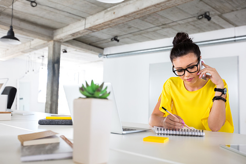 Creative Designer Working At Her Desk Stock Photo - Download Image Now