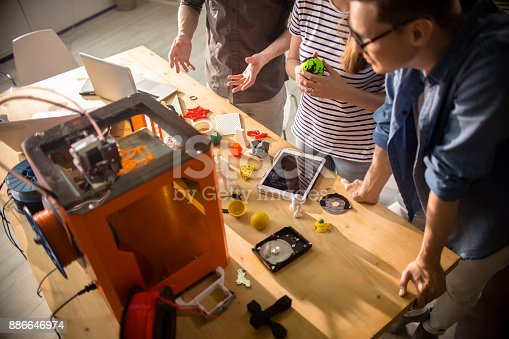 istock Creative Designers Using 3D Printer 886646974