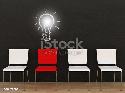 istock Creative different idea light bulb office chair blackboard 1066478798