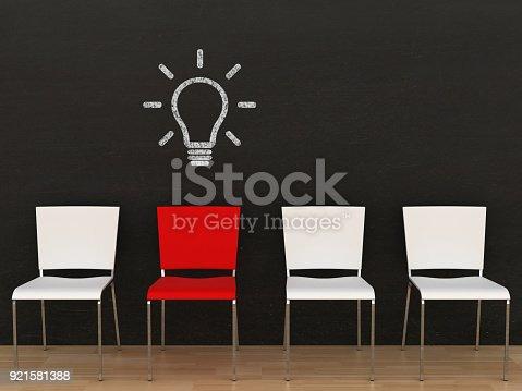 istock Creative different idea light bulb office chair blackboard 921581388
