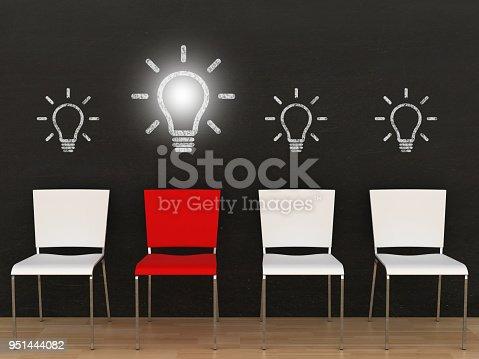 istock Creative different idea light bulb office chair blackboard 951444082